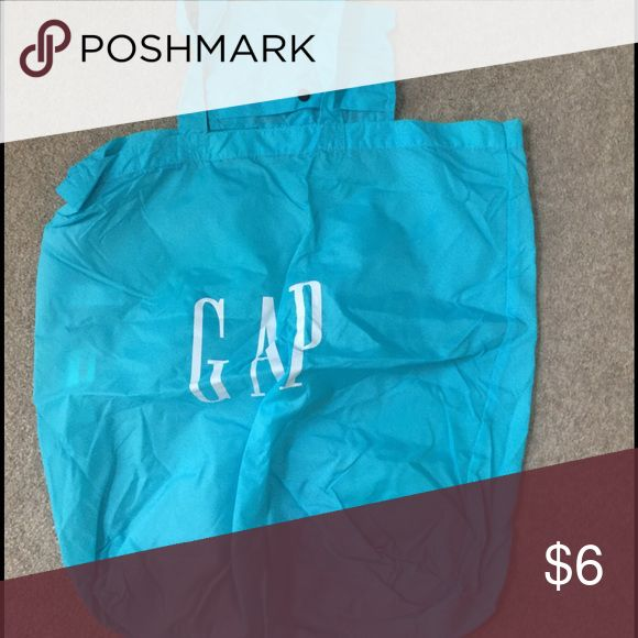 BUNDLE WITH THIS 😃Nylon Gap Shopping Bag Great thin blue nylon tote with inside picked. GAP Bags