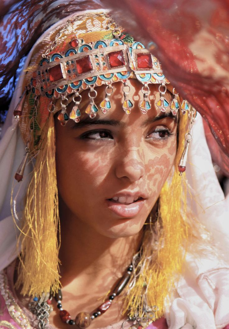 Moroccan- Berber woman, I love the headpiece and the tassels hanging from it. Really interesting colours and materials used.