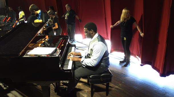 Holding the curtain down, as James Francies gets ready for the performance w/ 'Next Generation Jazz Orchestra'. 56th Annual Monterey Jazz Festival. Photo: Stephen Laufer / KUSP.: James Of Arci, Annual Monterey, 56Th Annual, Stephen Laufer, Monterey Jazz, James Francis, Jazz Festivals, Generation Jazz, Jazz Orchestra