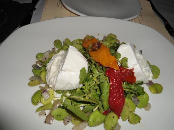 Burrata over greens, favas, and roasted peppers at Casa D'Angelo, Boca Raton, Fort Lauderdale, and Atlantis, Paradise Island, The Bahamas.