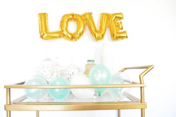 Fall in love with this mini gold LOVE Balloon! An easy and adorable decoration for an engagement party or bridal shower. Free shipping on TwigsandTwirls.com