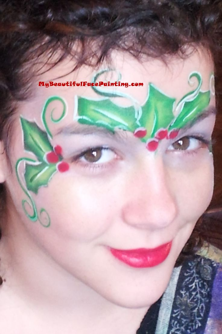 simple christmas crown face painting. Small Tag leaf split for leaves. Lips and berries in Tag red. Superstar white for accents.