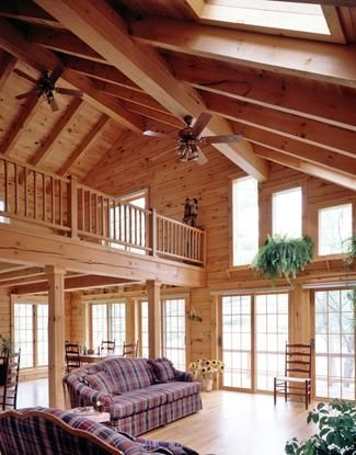 Log home great room with balcony and skylights  Great Rooms  Log home decorating Log homes