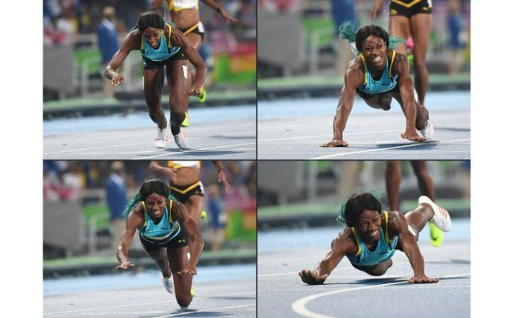 Bahamas's Shaunae Miller diving to cross the finish line to win the Women's 400m…