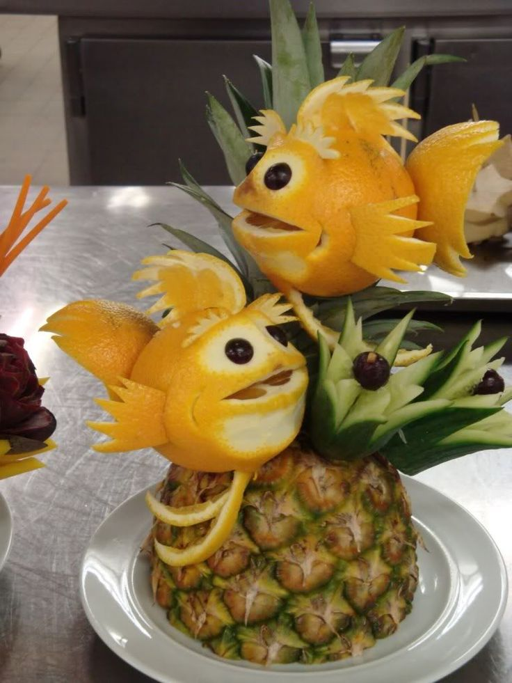 Tropical or Hawaiian party fruit centerpiece, fish from oranges and grapefruit.  A cute party food idea.  Compliments of Estate ReSale & ReDesign, LLC in Bonita Springs, FL where citrus is plentiful...