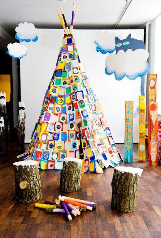 kids' multicolored teepee and darling tree stump stools. Wondering how the teepee is made?