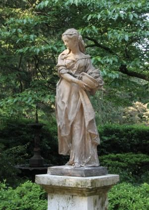 Rosedown Plantation in Louisiana.....one of many statues....this one is a figure of a Young Lady ~ Winter Season, cloaked and carrying a flame-filled urn. French, c. 1880 France..inspired me to buy my own
