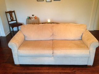 "Clean khaki couch with pull out bed in jberry's Garage Sale in DENVER , CO for $200.00. Clean khaki-colored couch with a fold out bed.  Rarely used couch which is in great condition.  arm rest to arm rest- 74""back to front- 35""height- 33"""