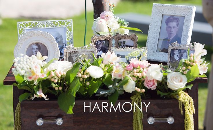 Heirloom vintage dresser with flowers and family photos <3