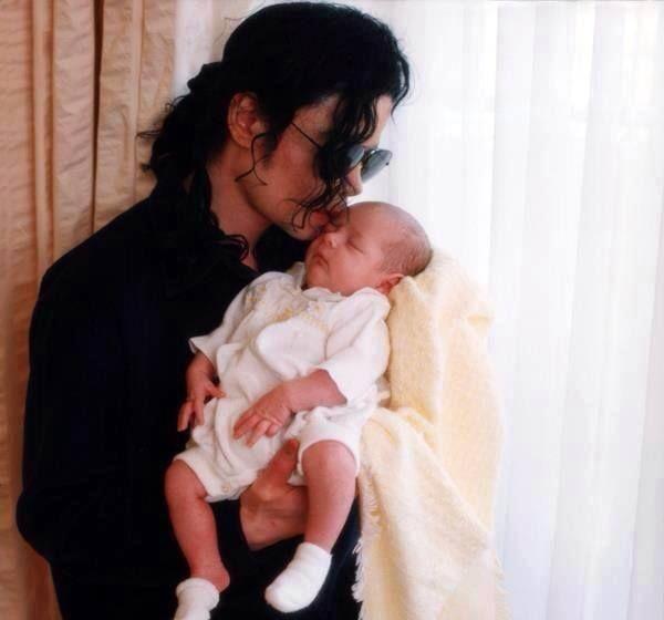 Michael Jackson with his baby daughter Paris