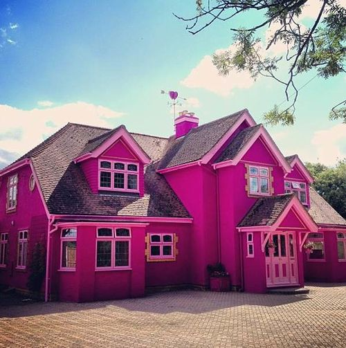 While not officially one of Barbie's many abodes, this eye-poppingly girly house in England just might be one of the most intensely fuchsia structures on the planet—more so than even its worthiest competitors. Amy—the owner of the fuchsia manse—moved out to the English countryside about three years ago to build her dream home, and now lives full-time within its candy-colored walls.