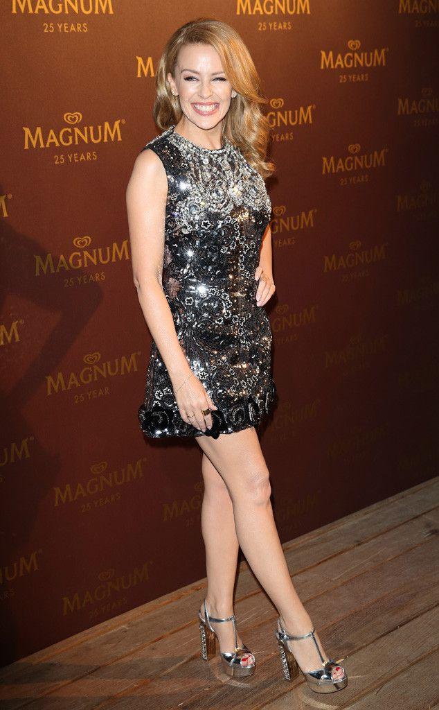 Kylie Minogue sports a flirtatious beaded mini dress. So fun!