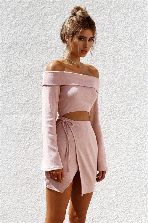 The perfect party dress, the Ribbed Renata Dress is made from a thick ribbed fabric in a pink hue. It is an off shoulder style and features a folded panel along shoulders, full length sleeves, cutout at waist and wrap skirt feature. Complete the look with tan heels! By Sabo Skirt.