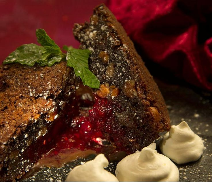 Gooey chocolate & hazelnut brownie, served with fresh raspberry compote & whipped cream #BombayBicycleClub