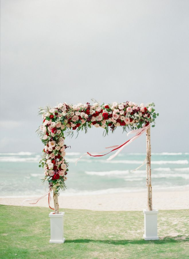 Romantic floral + ribbon covered ceremony arbor: http://www.stylemepretty.com/little-black-book-blog/2016/06/30/red-hawaiian-wedding/ | Photography: Aria Studios - http://www.ariastudios.com/