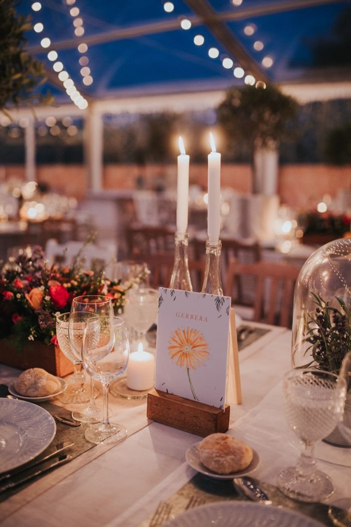 pretty water-colored table markers painted by the bride  | Image by  Hugo Coelho Fotografia