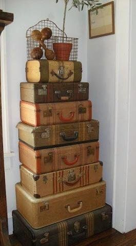Make a luxe home statement, channel travel inspired chic with a stack of vintage suitcases.