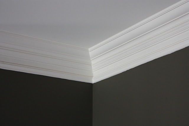 Create illusion of thick crown molding by installing basic crown molding and then 3 in. below install decorative picture frame molding.  When painted, it looks like one large, piece