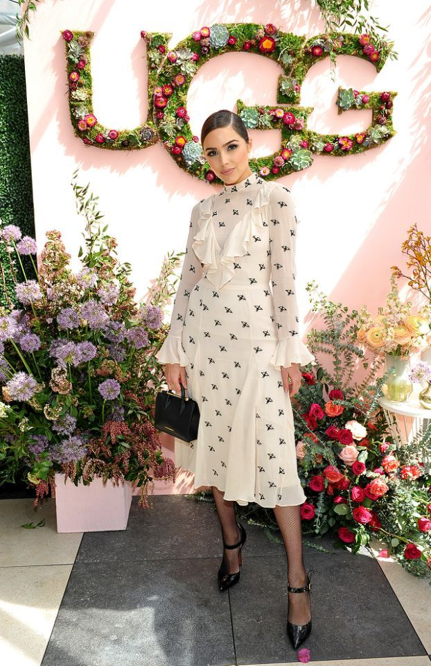 Miss Universe 2012 was pretty as a picture in the ruffled Temperley Londonfrock she wore to the Ugg spring/summer '17 campaign luncheon in Los Angeles. She added a little edge to her look with a sleek 'do, fishnet stockings, and pointy pumps. (Photo: Donato Sardella/Getty Images for Ugg)