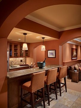 Media Room and Bar with Burnt Orange Walls (Sherwin Williams SW 6634, Copper Harbor) - Gelotte Hommas Architecture, gelottehommas.com