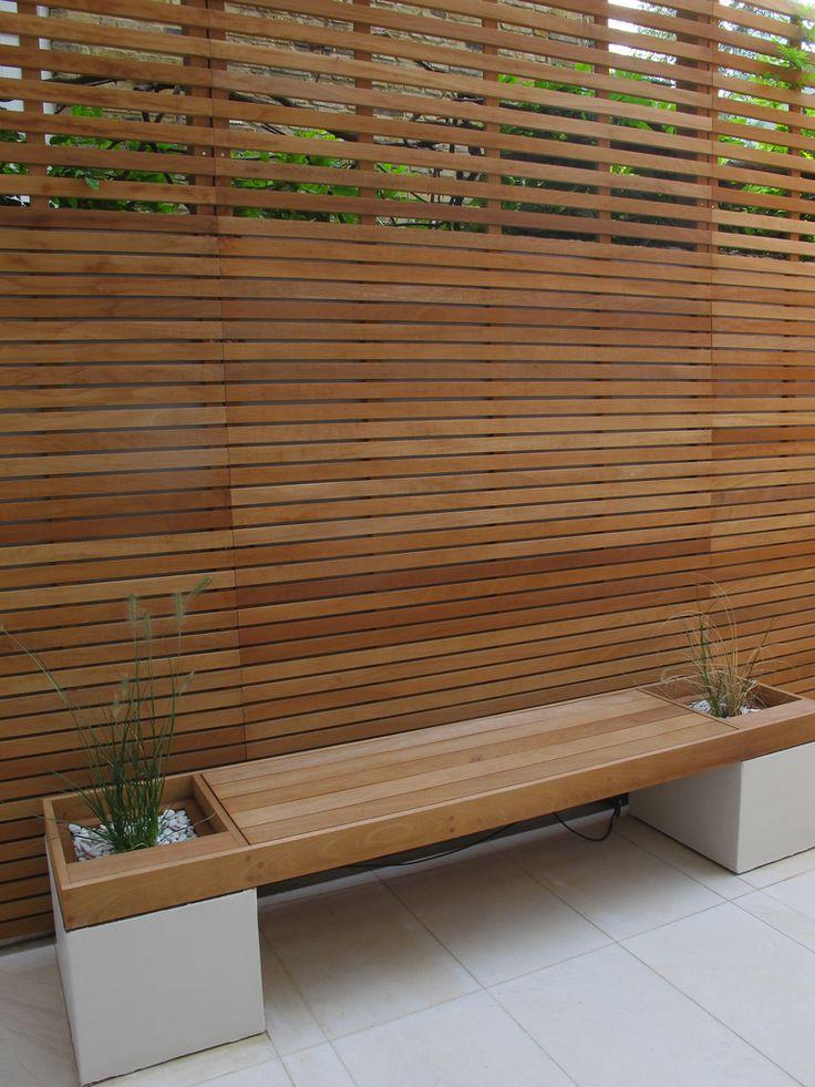 fence and interesting outdoor furniture. Charlotte Rowe - garden designer