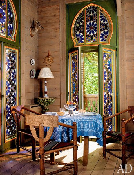 In one corner of the salon is a dining area with circa-1900 Russian chairs made at the Talashkino workshops.