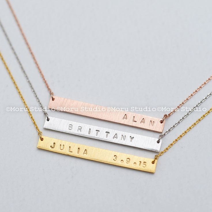 Personalized Gold Name Bar Necklace/ Long Skinny Bar Necklace,Handstamped Initial Necklace,Custom Silver Necklace,Birthday Mom Gift NBR003-2 by MoruStudio on Etsy  Our bar necklaces are thick and have our signature hand-brushed finish. It may be personalized with a single name of yourself and a loved one (as silver and rose gold in photos), a 'name and date' (as gold in photos ) or 'two names'.  #Personalized #GoldNameBarNecklace #LongSkinnyBar #PersonalizedNecklace #HandstampedInitial