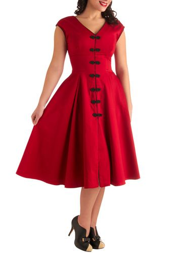 I covet this dress! So lovely! Fun and flirty but modest too. And it's red!