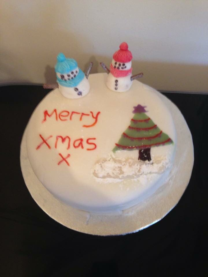 Vanilla sponge cake with butter cream and raspberry jam filling. Funnily decorated with royal icing.