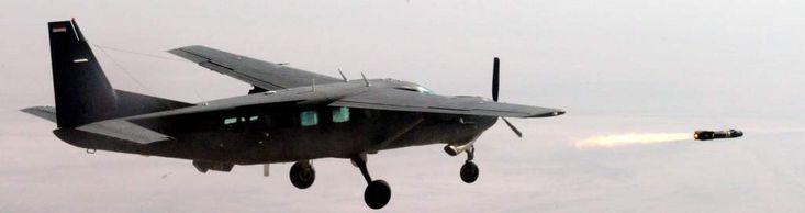"""retrowar: """"An Iraqi Air Force Cessna 208B Grand Caravan launches Hellfire missile """""""