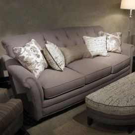"""Tufted sofa with nailhead-trimmed upholstery and kiln-dried framing. Made in the USA.  Product: SofaConstruction Material: Kiln-dried hardwood, fabric and foamColor: GrayFeatures: Made in the USADimensions: 39"""" H x 83"""" W x 40"""" D"""
