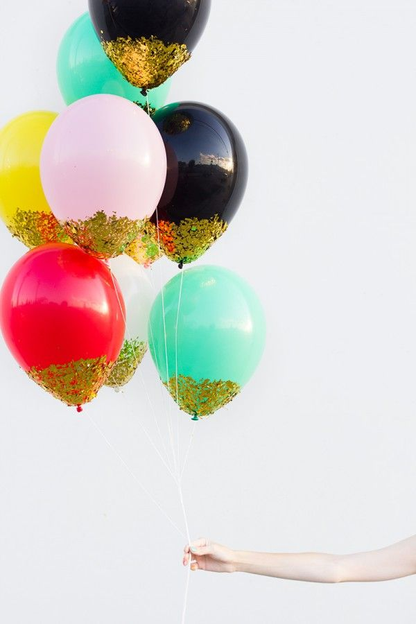 DIY Confetti Dipped Balloons! These would be amazing party decor! We also love them as a gift to someone extra special who appreciates details.