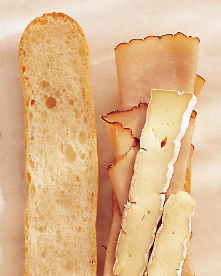 Brie, ham, mustard, and a baguette are all the ingredients you need to make this flavorful sandwich.