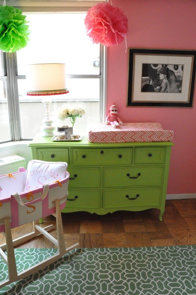 love the combo of bright green and pink in this girl's nursery