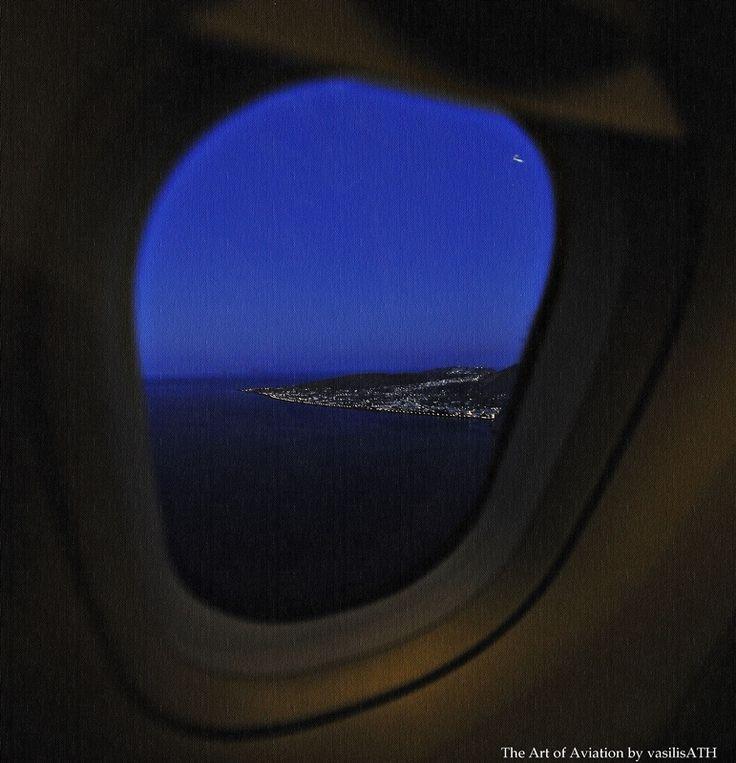 Approaching for landing in Santorini.  Τhe lights of Perissa