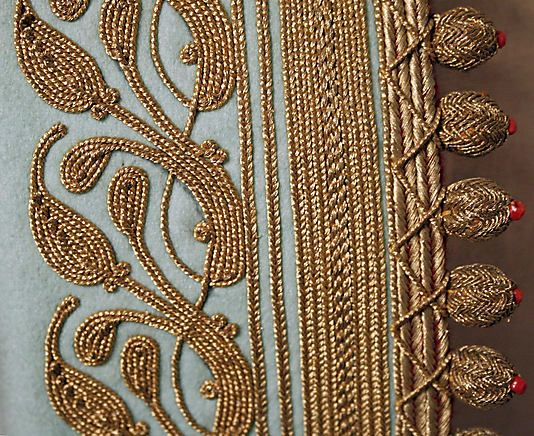 button and embroidery detail like the Tiffany-blue Albanian coat at the Met, 1900's
