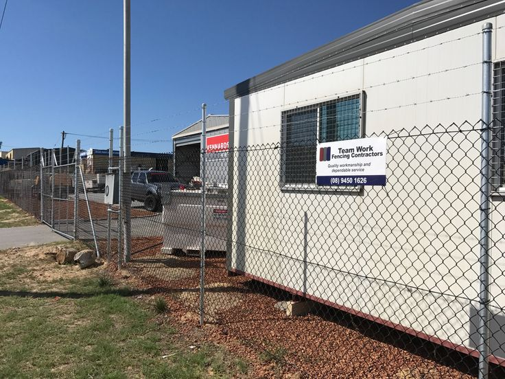 Professional chainmesh installation for a client in Perth, with black PVC chainlink and galvanised posts.