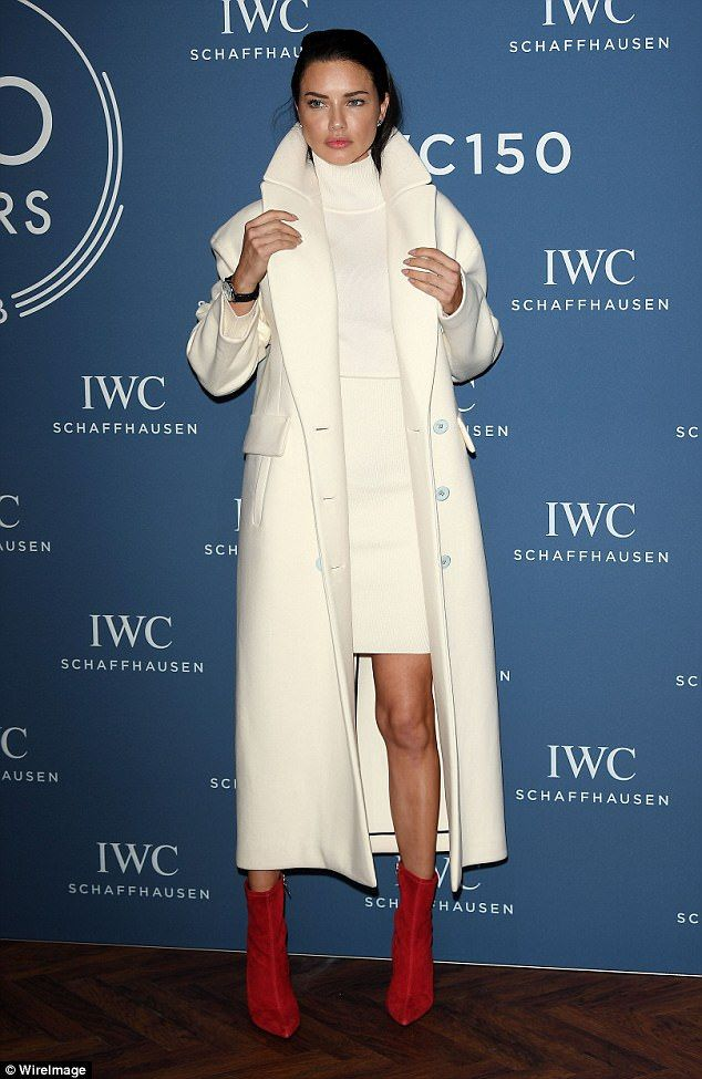 Catching the eye:The fashion star added extra height to her frame with a pair of striking scarlet red sock boots, that made sure to elongate her already lengthy legs