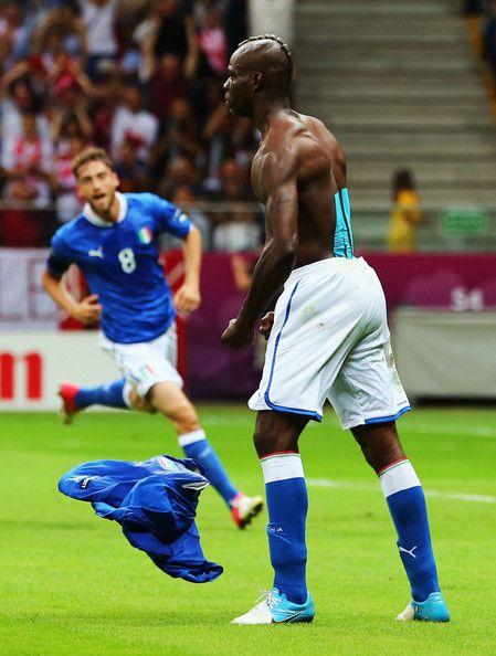 Mario Balotelli of Italy removes his shirt as he celebrates after scoring his team's second goal during the UEFA EURO 2012 semi final match between Germany and Italy at the National Stadium on June 28, 2012 in Warsaw, Poland.