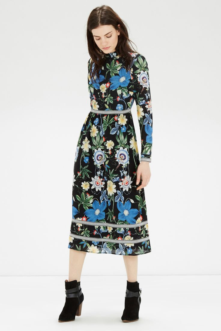 This midi dress is constructed from luxurious silk and features a high neck,a concealed zip on the back, full length sleeves with button cuffs and an all over botanical floral design. Length of dress, from shoulder seam to hem, 123cm approx. Height of model shown: 5ft 10 inches/178cm. Model wears: UK size 10.