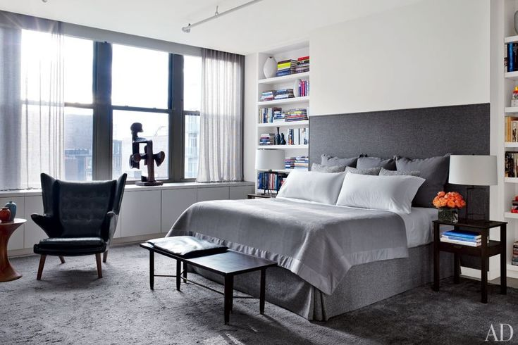 The master bedroom is anchored by a Hästens bed with a custom-made headboard; the sculpture on the windowsill is by Dal Fabbro from Maison Gerard.