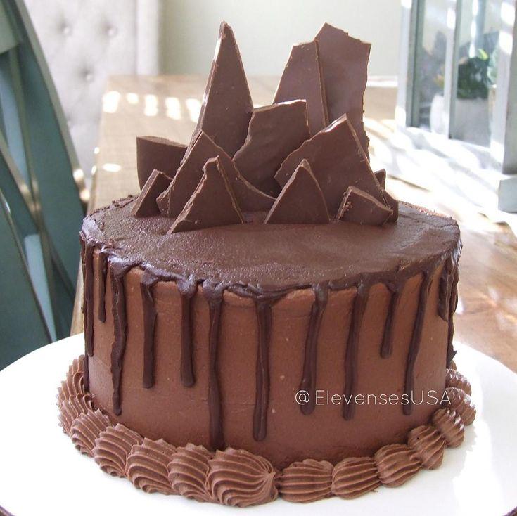 Chocolate drip cake topped with hardened chocolate shards