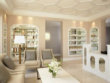 my spa waiting room with all different kinds of moisturizers for your body on the walls