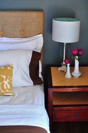 Honduras styles bedroom. Burlap headboard.  Woven texture side table.