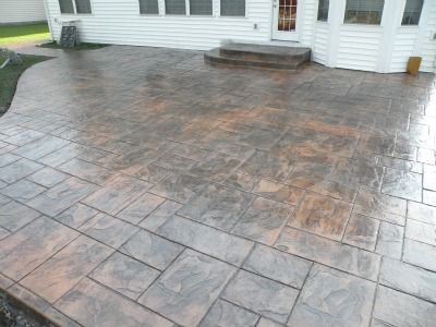 Stamped with majestic ashlar pattern. Concrete color - sonoran tan Release color - medium gray, walnut, terra cotta