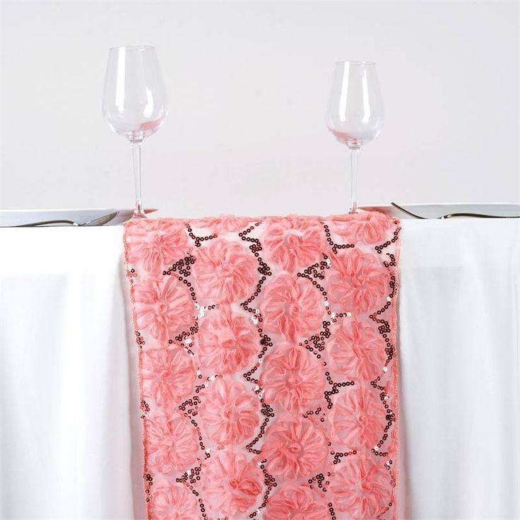 Wholesale Rose Quartz Tulle Table Runner With Sequin Design Party Wedding Tabletop Decoration | Few fabrics are designed by the master designers, simply with the intention to stand out and glam up the bearer, whether it's a hip celeb, or a truly posh party. This unique piece features absolutely voguish design of shimmery satin ribbons twirling and swirling into eye-catching flowers and coils atop a stunning see-through tulle. The glitzy sheen of satin ribbons coupled with glamorous sheer…