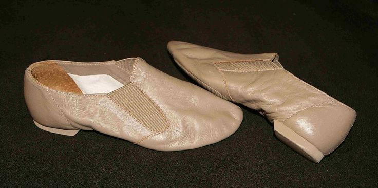 Jazz Acro Shoes - Jazz shoes typically have a two-part rubberized sole (also called split-sole) to provide both flexibility and traction, and a short heel. They are secured to the foot by laces or elastic inserts.