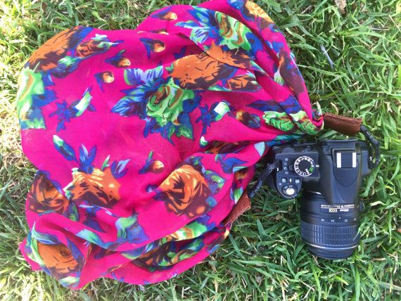 How cute is this?! It's the perfect gift for your snap-happy photographer friend. Add it to your wish list today!  bright pink floral scarf camera strap  Nikon Canon DSLR photography christmas gift