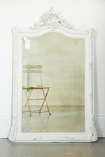 white ornate floor mirror
