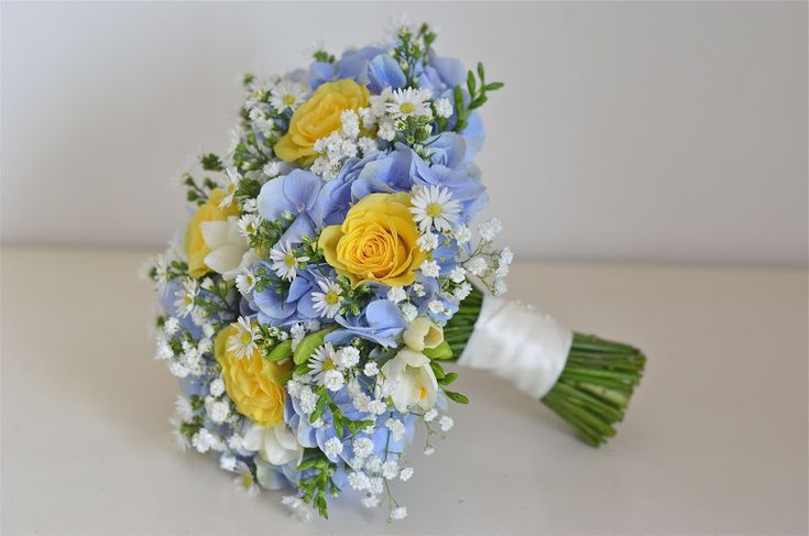 """Yellow roses, blue hydrangea, freesias, """"daisies"""" ( Aster) and gypsophila make a gorgeous bouquet. *Replace daisy with orchid or babies breath"""